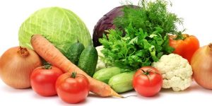 A diet low in sugar and rich in veggies is essential in treating acne.